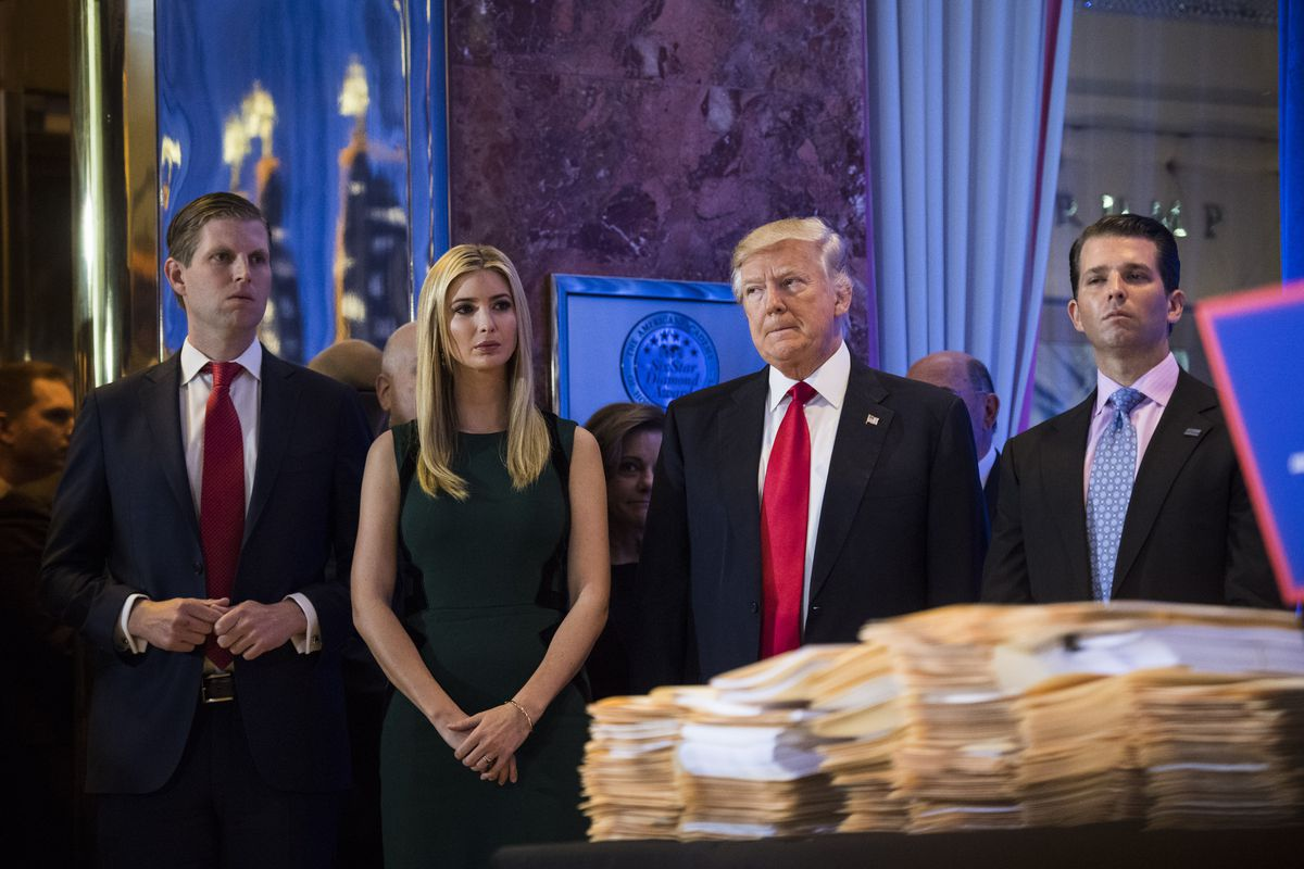 Donald Trump and his family stand in front of papers they say are his tax returns.