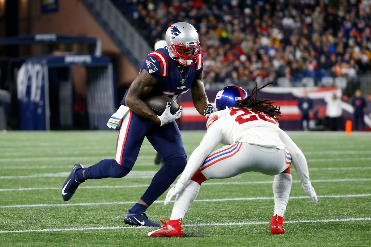 New England Patriots wide receiver Josh Gordon rushes against New York Giants cornerback Janoris Jenkins during the first half at Gillette Stadium.