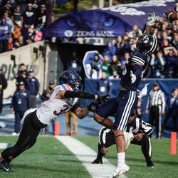 BYU wide receiver Samson Nacua reaches for the ball as Boise State safety Alexander Teubner defends during an NCAA college football game at LaVell Edwards Stadium in Provo on Saturday, Oct. 9, 2021.