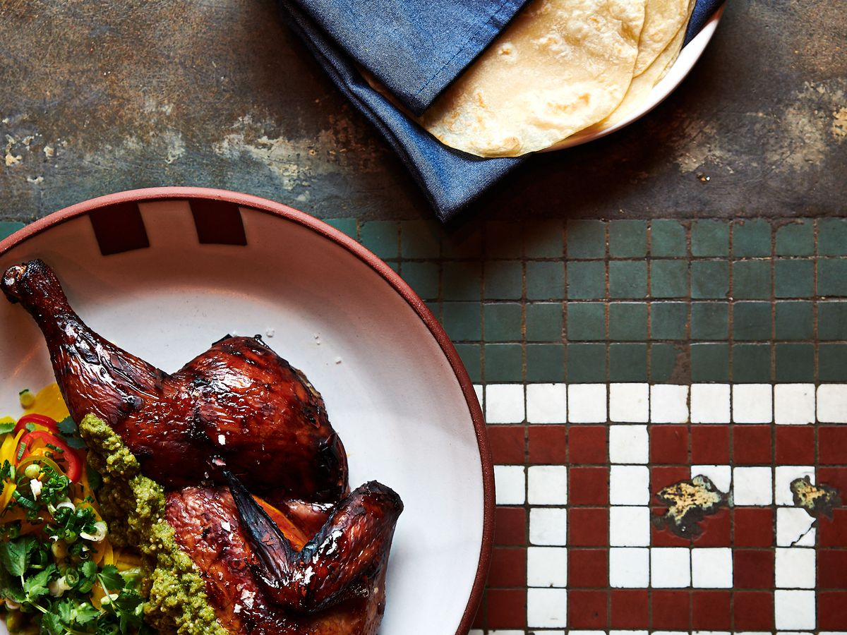 Smoked chicken at Bullard, served with a green salsa and a pile of wrapped tortillas