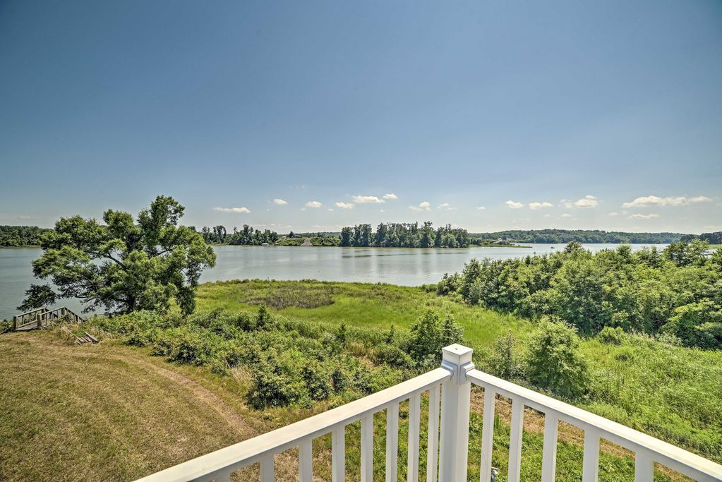 The view from the porch of a waterfront home in Montross, Virginia, showing water, grass, and trees.