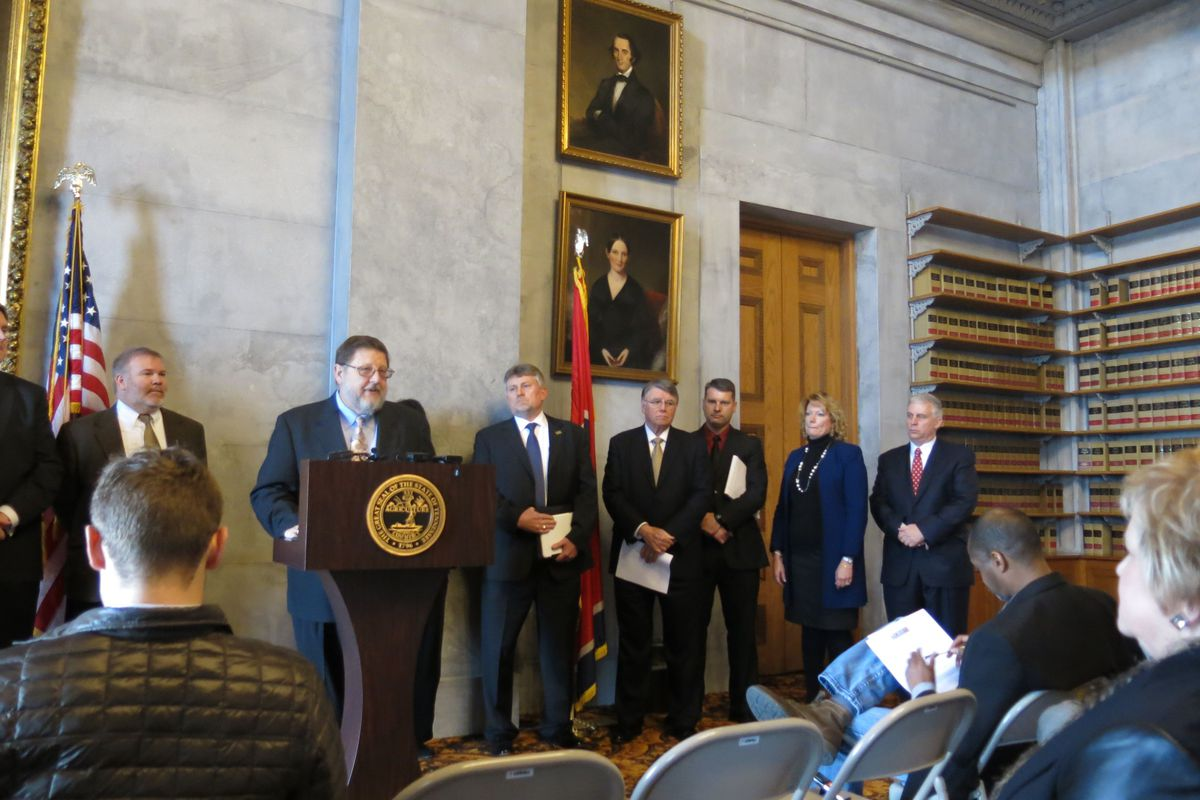 Flanked by several school district superintendents and directors, spokesman Wayne Miller addresses media at the State Capitol in January. Miller is executive director of the Tennessee Organization of School Superintendents.