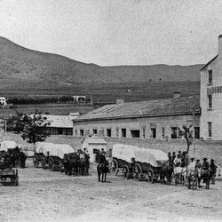 From the Ottinger collection an early image of pioneers in front of the Deseret Store on South Temple in the 1860's.