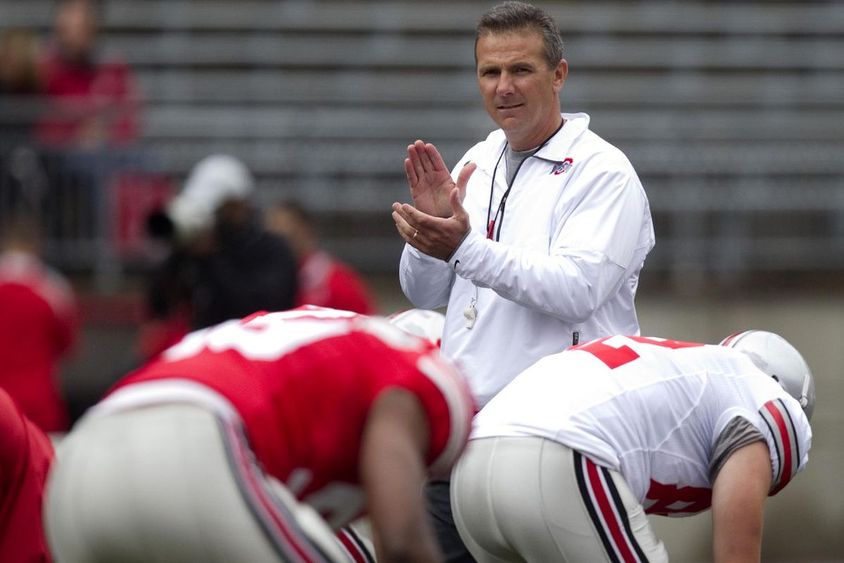 April 21, 2012; Columbus, OH, USA; Ohio State Buckeyes head coach Urban Meyer watches as his team stretches out before the spring game at Ohio Stadium.  Mandatory Credit: Greg Bartram-US PRESSWIRE