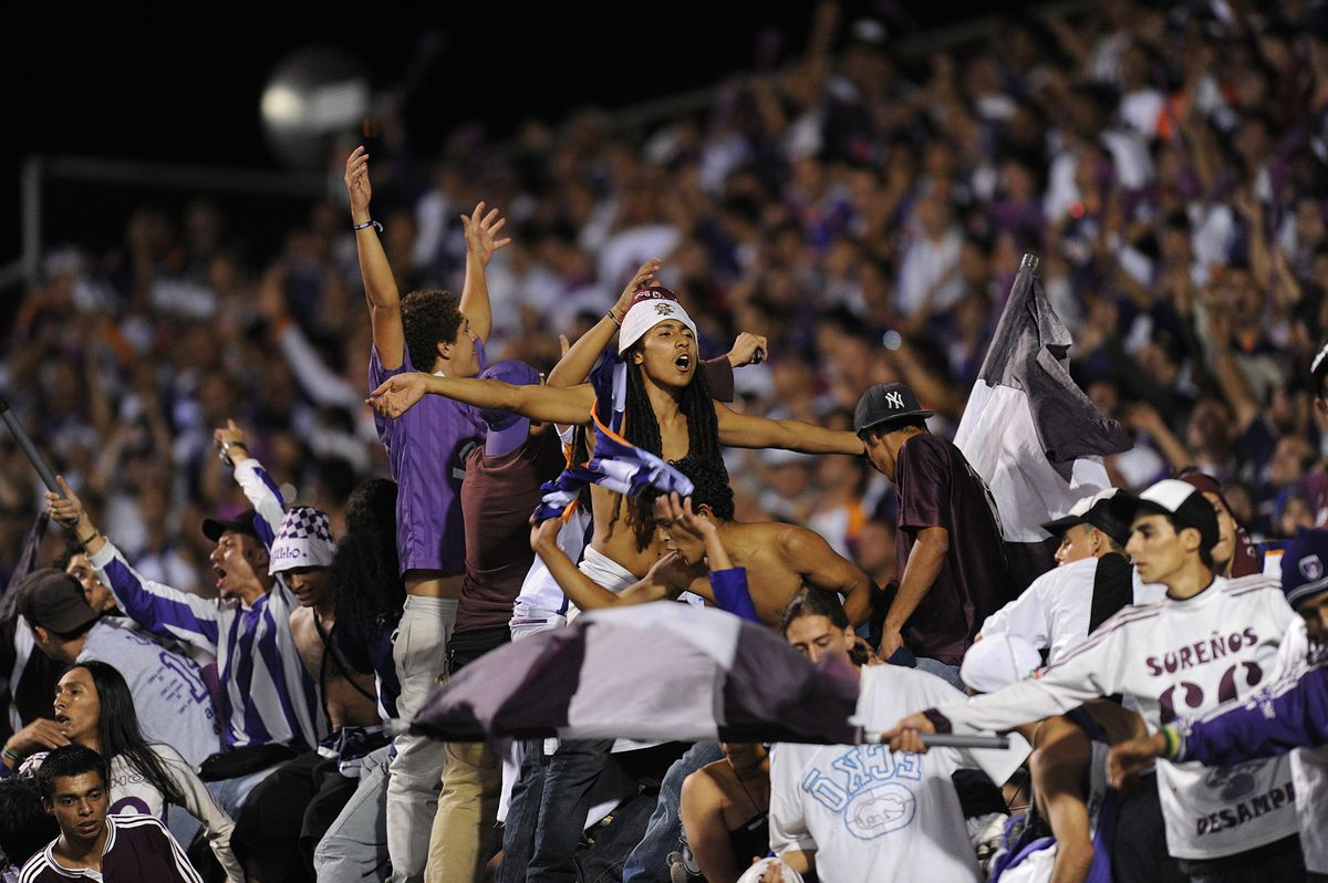 Fans of Saprissa celebrate after their t