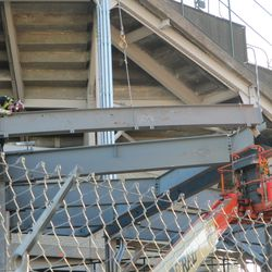 Girder being placed into position, behind the scoreboard -