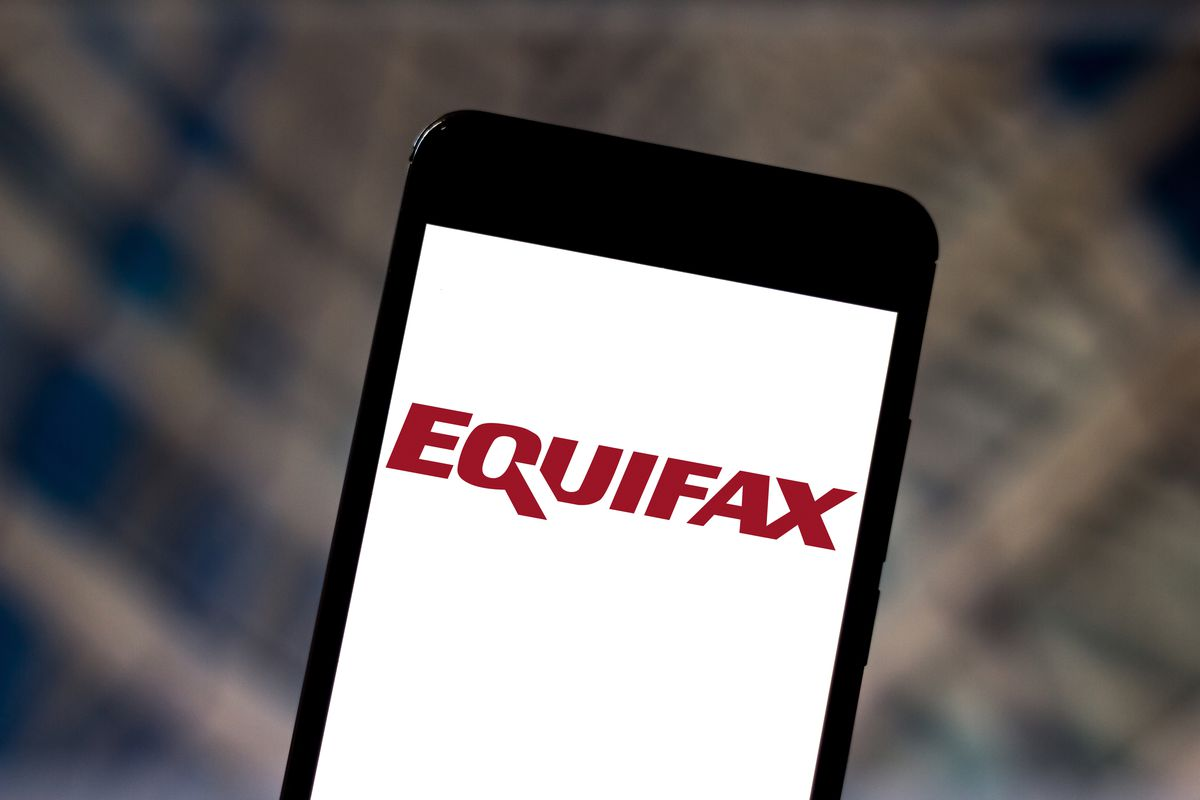 Equifax logo on a smartphone screen.