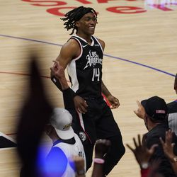 Los Angeles Clippers guard Terance Mann celebrates with fans after scoring during the second half in Game 6 of a second-round NBA basketball playoff series against the Utah Jazz Friday, June 18, 2021, in Los Angeles.