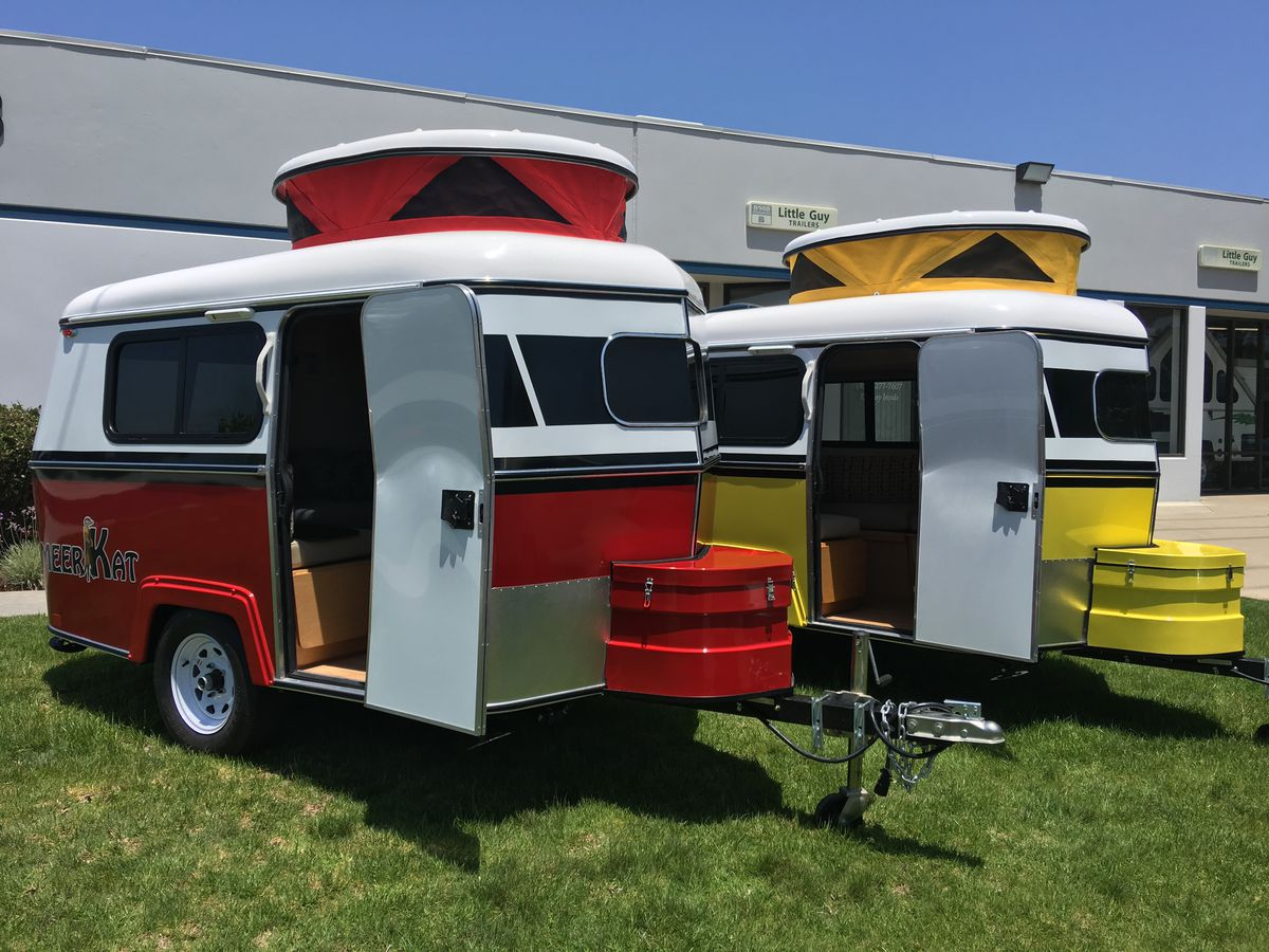 Two small camper trailers in red and yellow