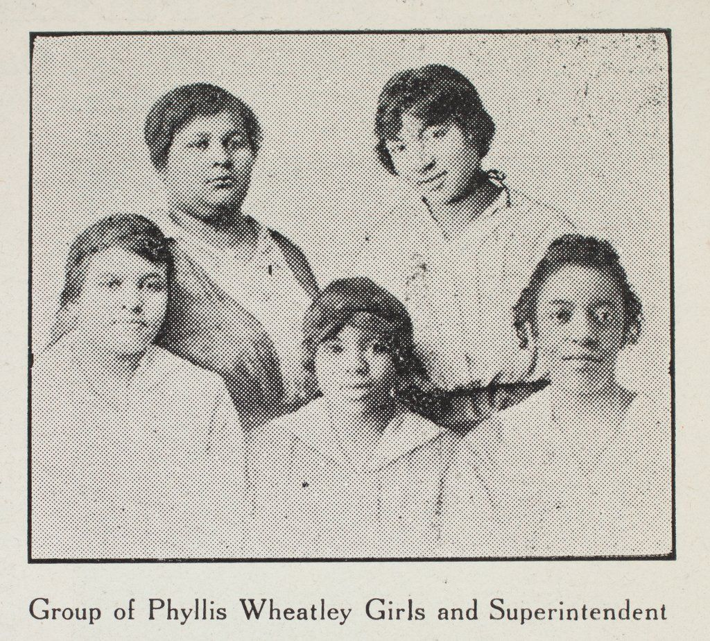 """In 1918, the residents of one of the previously demolished Phyllis Wheatley Homes, pictured with their """"superintendent,"""" or house mother. Women and girls who resided in the homes were known as """"Wheatley Girls."""""""