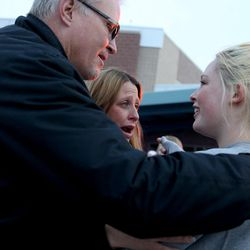 Jamie Brewer cries while seeing her daughter, Katie Bushman, an 11th-grader, after a lockdown at the high school was lifted Thursday, Dec. 3, 2015. Pleasant Grove High School was placed on lockdown after receiving reports of a man with a weapon inside the school.