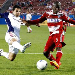 FRISCO, TX - APRIL 25:  Tony Beltran #2 of the Real Salt Lake (L) fights for control of the ball against Jair Benitez #5 of the FC Dallas at FC Dallas Stadium on April 25, 2012 in Frisco, Texas.  (Photo by Tom Pennington/Getty Images)