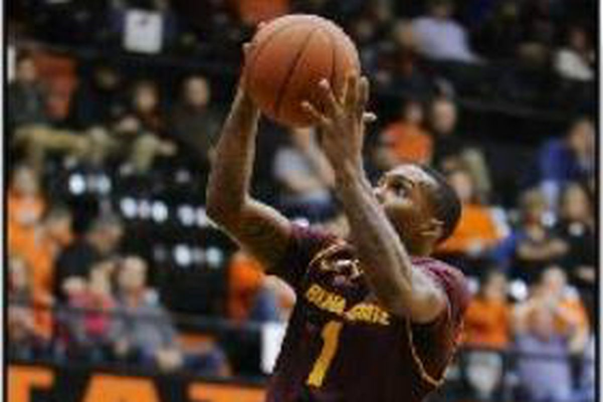 Arizona St.'s Jahii Carson eludes Oregon St.'s Ahmad Starks for 2 of his game high 20 points.
