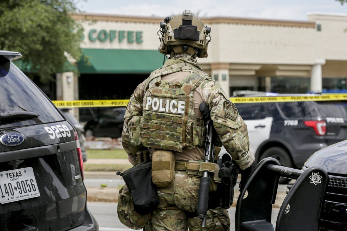 Austin police, SWAT and medical personnel respond to an active shooter situation located Great Hills Trail in Northwest Austin, Texas, on Sunday, April 18, 2021. Emergency responders say several people have been fatally shot in Austin and that no suspect is in custody.
