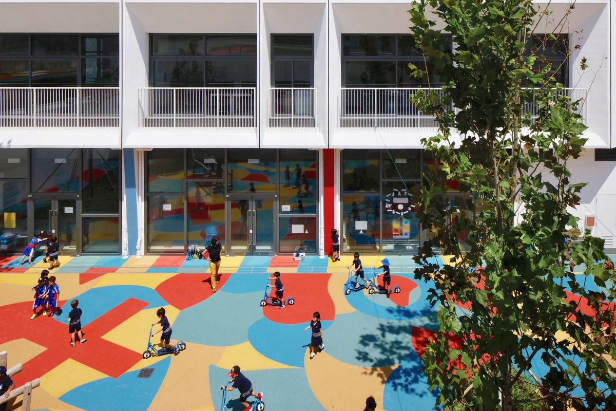 Kids playing in outdoor area with patterned floor