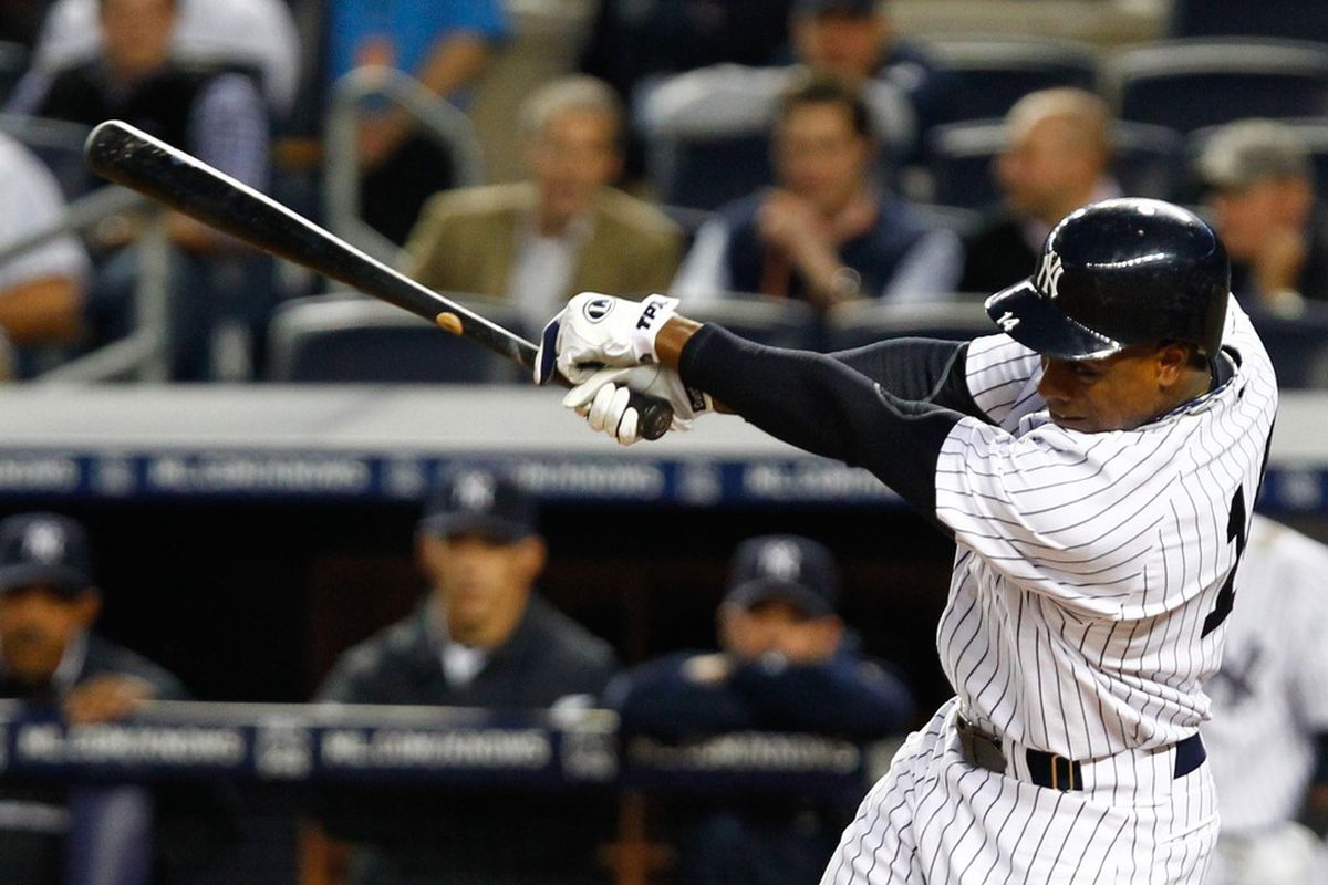May 1, 2012; Bronx, NY, USA; New York Yankees center fielder Curtis Granderson (14) singles to right during the fourth inning against the Baltimore Orioles at Yankee Stadium. Orioles won 7-1. Mandatory Credit: Debby Wong-US PRESSWIRE