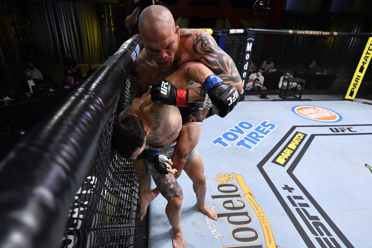 Anthony Smith grapples with Aleksandar Rakic of Austria in their light heavyweight fight during the UFC Fight Night event at UFC APEX on August 29, 2020 in Las Vegas, Nevada.