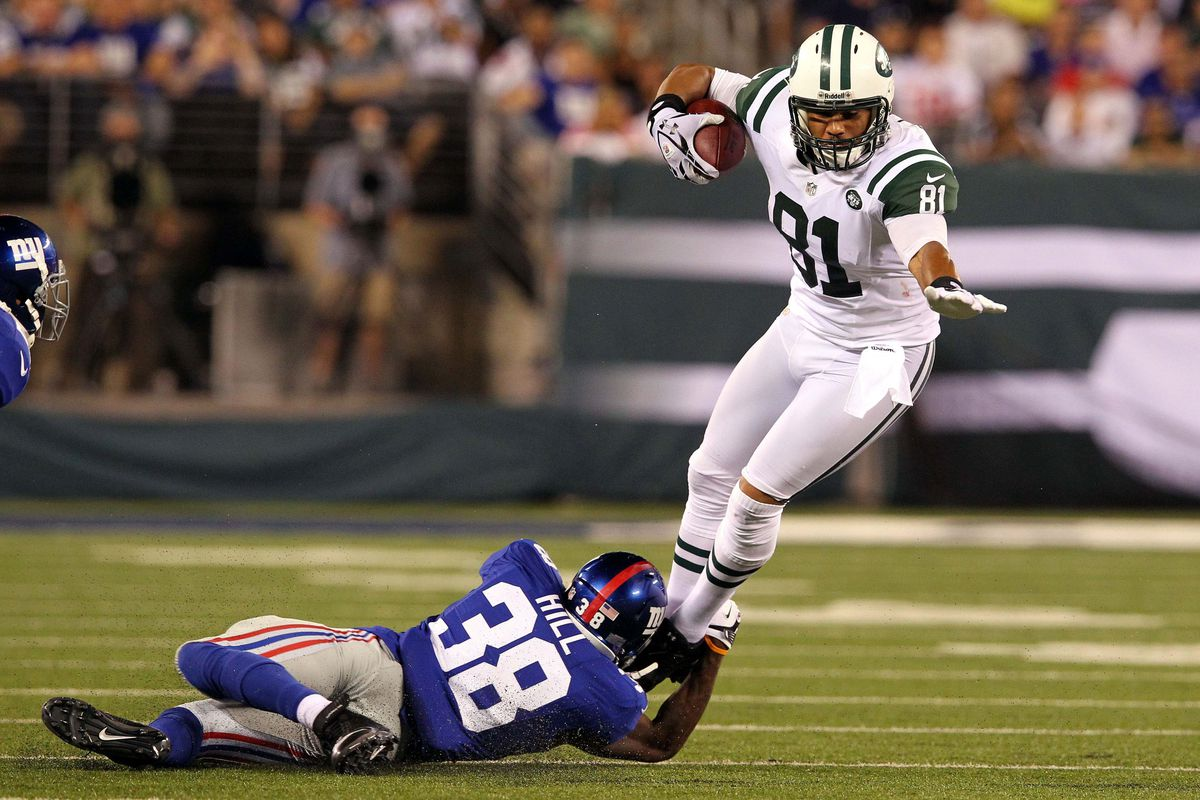 August 18, 2012; East Rutherford, NJ, USA; New York Jets tight end Dustin Keller (81) tries to avoid being tackled by New York Giants safety Will Hill (38) during the second quarter of a preseason game at MetLife Stadium. Brad Penner-US PRESSWIRE