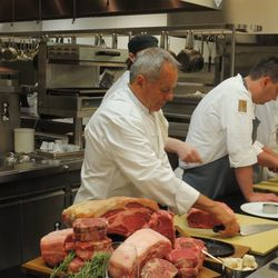 Wolfgang Puck hands out raw beef for guets to try.