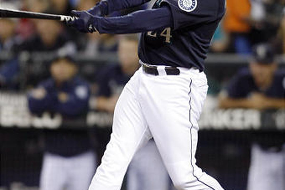 Seattle Mariners' Ken Griffey Jr. hits a solo home run on a pitch from Tampa Bay Rays' Jeff Niemann.