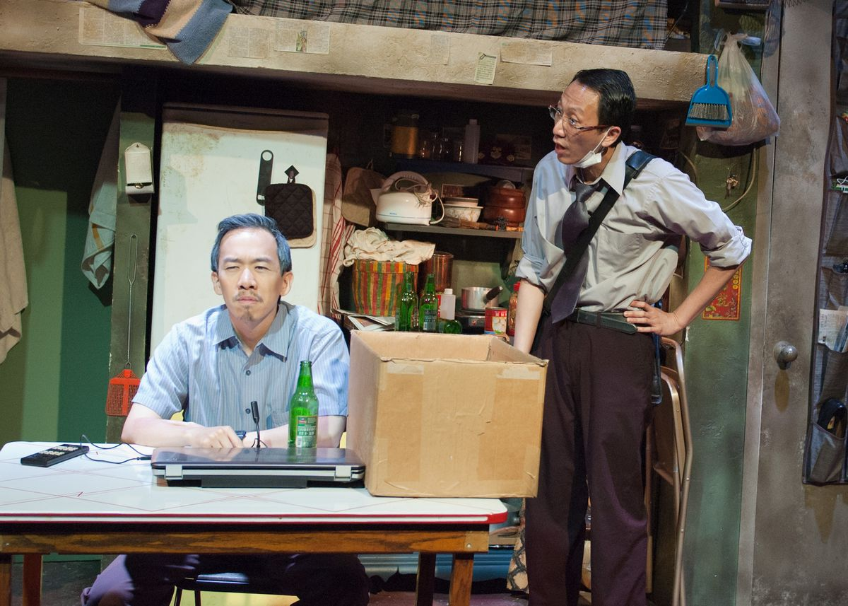 """Norman Yap left and Wai Yim in """"Chimerica,"""" at TimeLine Theatre. (Photo: Lara Goetsch)"""