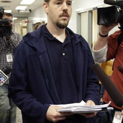 Josh Powell, the husband of missing Utah woman Susan Powell, is surrounded by reporters as he leaves a Pierce County courtroom, Sept. 23, 2011, in Tacoma, Wash.