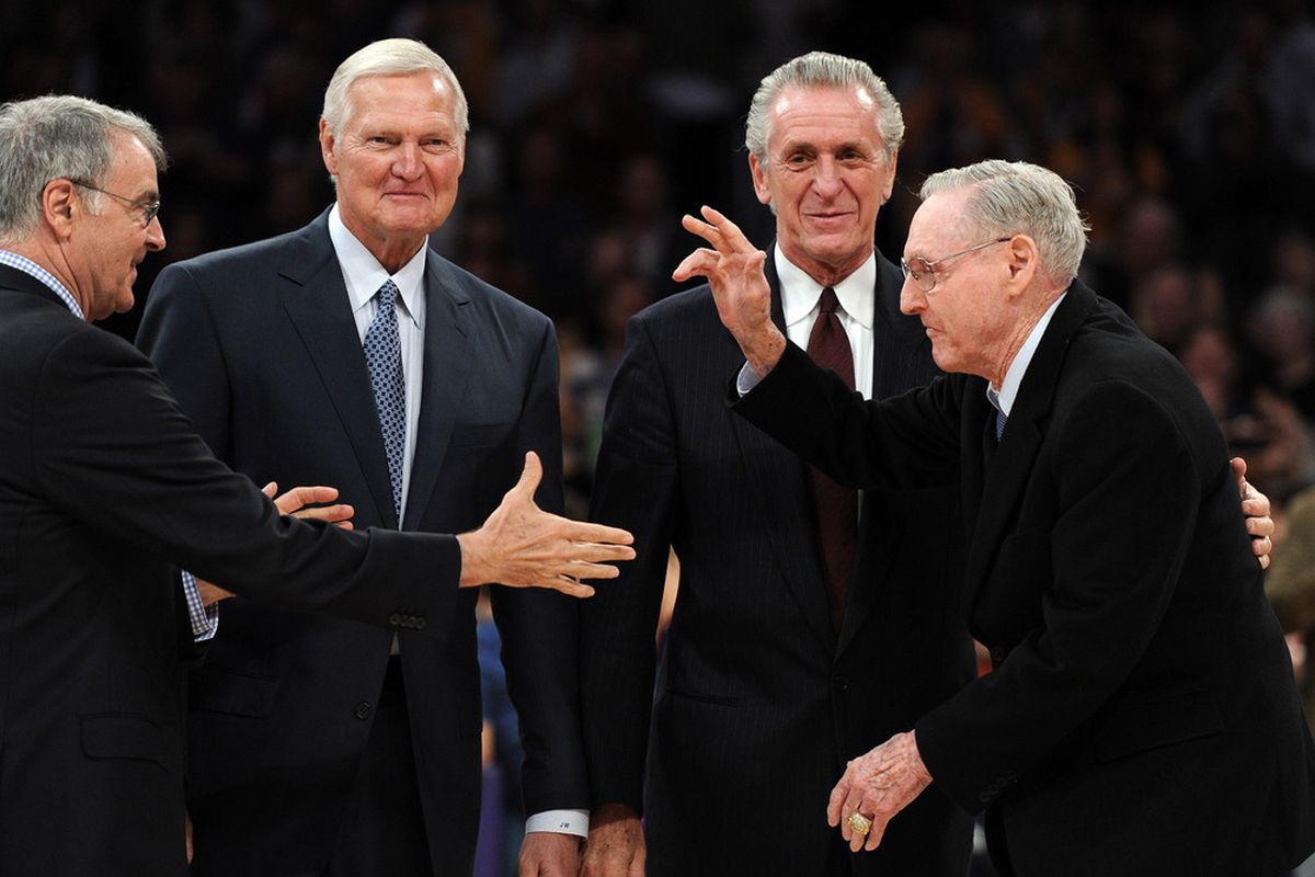 LOS ANGELES, CA - APRIL 06:  Bill Sharman receives a handshake from Gail Goodrich in front of Jerry West and Pat Riley, two men who have made more than their fair share of trades. (Photo by Harry How/Getty Images)