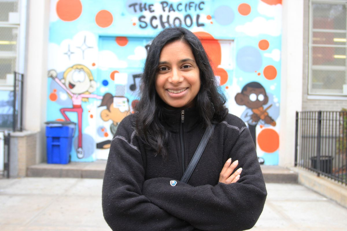Mishi Faruqee stands outside her daughter's school, P.S. 38 The Pacific School in Boerum Hill, Brooklyn.