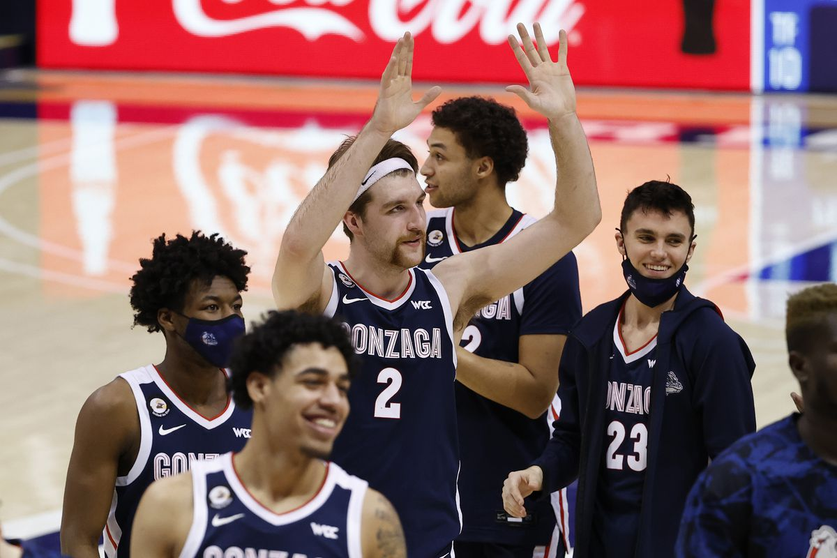 Gonzaga Bulldogs forward Drew Timme celebrates with his teammates after their win against the Brigham Young Cougars at Marriott Center.