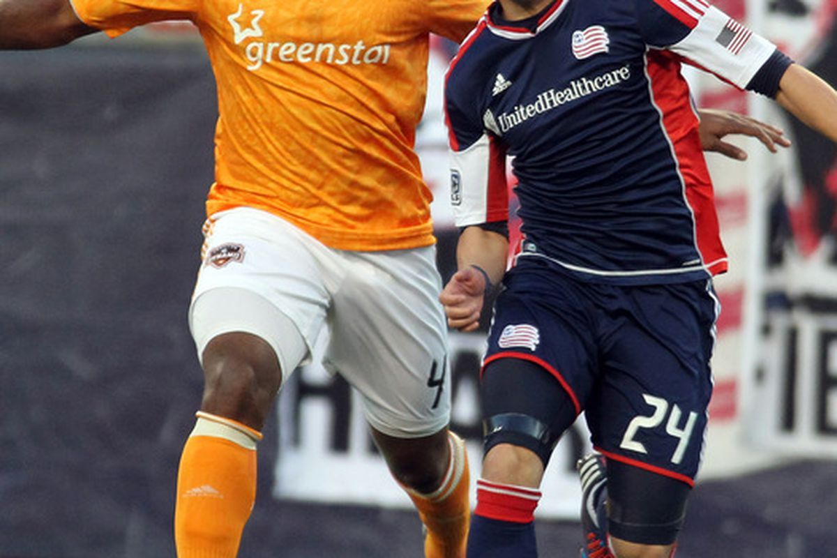 May 19, 2012; Foxborough, MA, USA; Houston Dynamo defender Jermaine Taylor (4) defends against New England Revolution midfielder Lee Nguyen (24) during the first half at Gillette Stadium. Mandatory Credit: Stew Milne-US PRESSWIRE