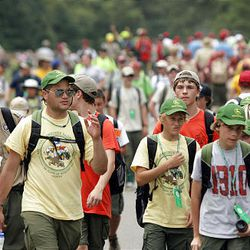 Boy Scouts walk to activities at the National Scout Jamboree at Fort AP Hill in Virginia Tuesday. Scouts from Utah are attending the event.