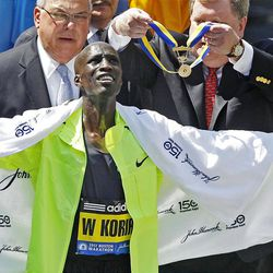 Wesley Korir, of Kenya, celebrates after winning the 116th Boston Marathon in Boston, Monday, April 16, 2012. (AP Photo/Charles Krupa)
