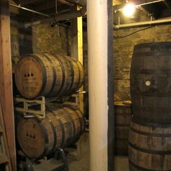 Wooden barrels in the brewery's basement for aging beer which may include barrels from Kentucky's Buffalo Trace distillery.