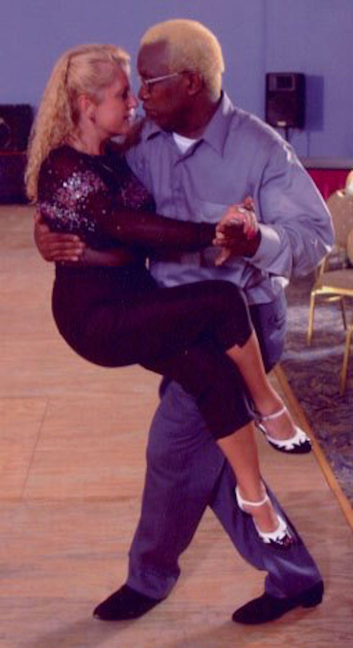 Leroy Hearon demonstrating tango with Phoebe Grant.