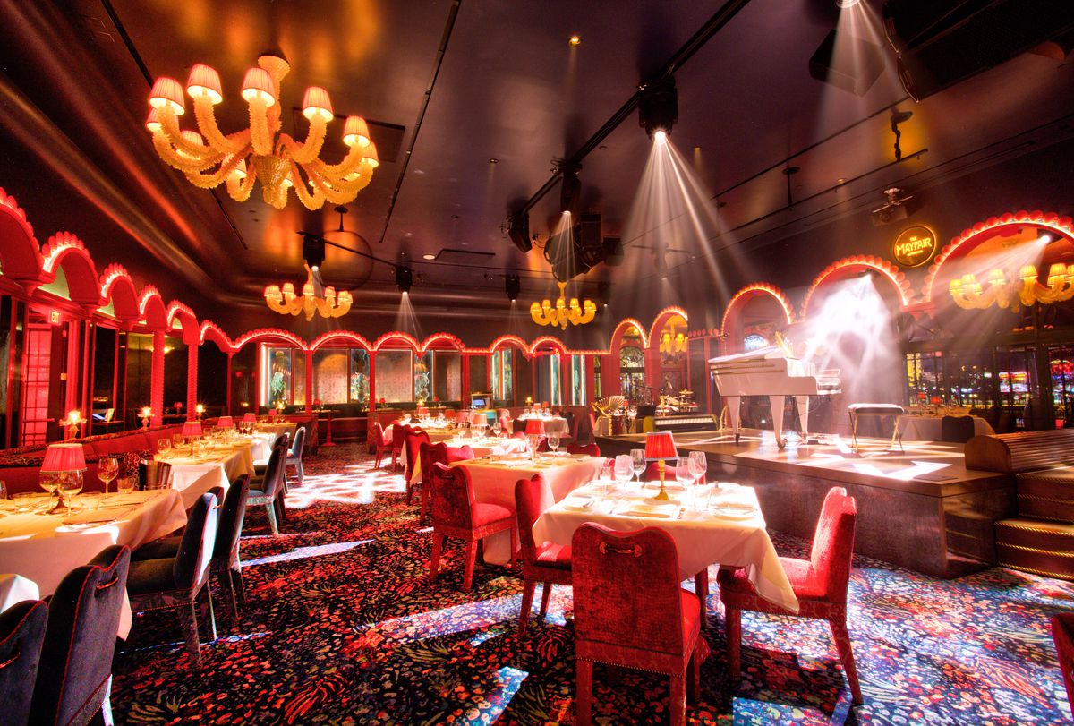 The dining room and stage in the middle room at The Mayfair Supper Club