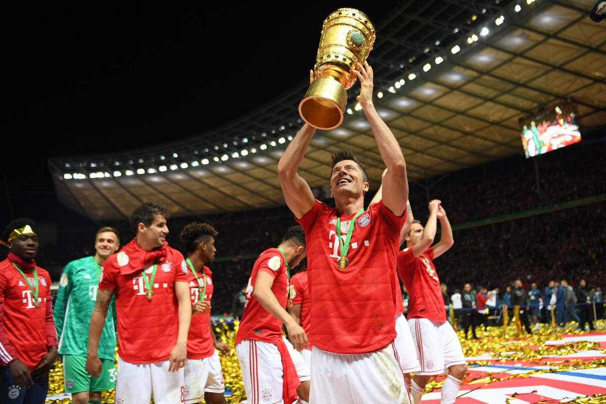 BERLIN, GERMANY - MAY 25: Robert Lewandowski of Bayern Munich celebrates victory with the trophy after the DFB Cup final between RB Leipzig and Bayern Muenchen at Olympiastadion on May 25, 2019 in Berlin, Germany.