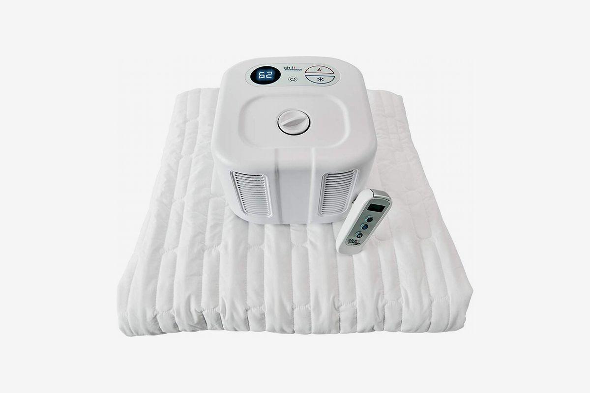 Plastic white device on a white mattress pad.