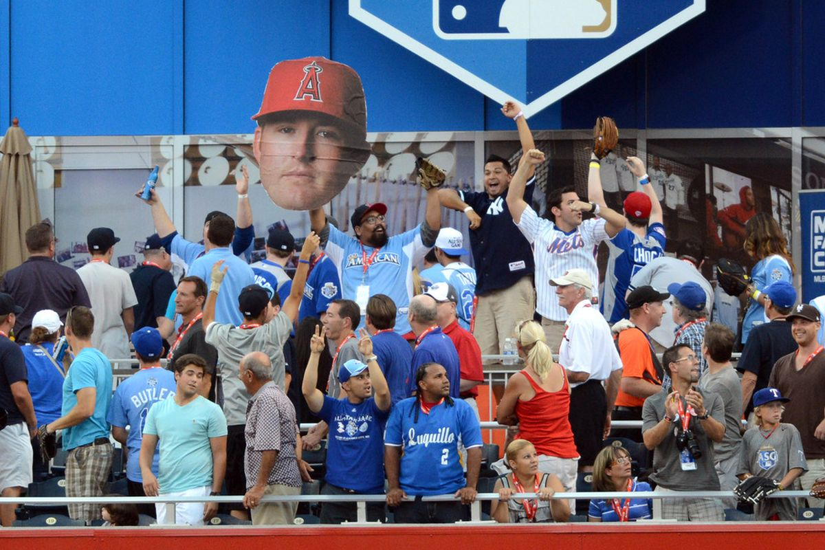 July 9, 2012; Kansas City, MO, USA; Fans cheer for American League outfielder Mark Trumbo (not pictured) of the Los Angeles Angels during the 2012 Home Run Derby at Kauffman Stadium.  Mandatory Credit: Denny Medley/USA TODAY Sports via US PRESSWIRE