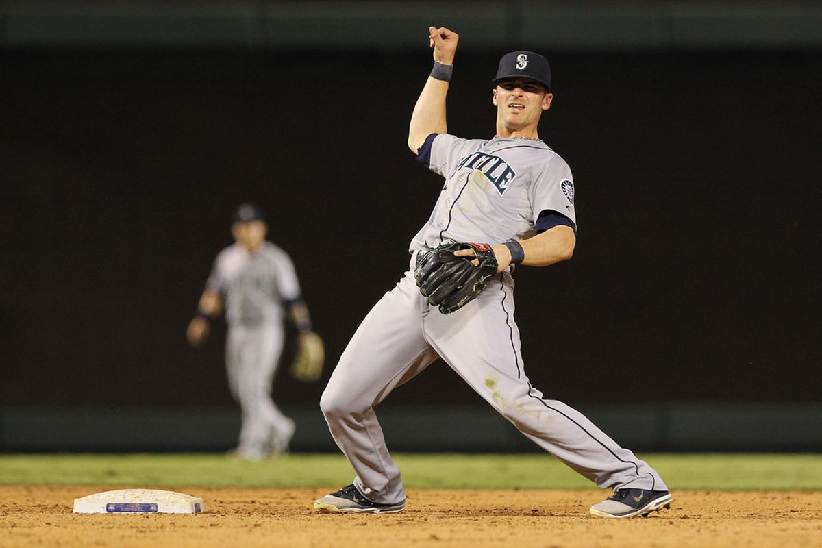 May 30, 2012; Arlington, TX, USA; Seattle Mariners second baseman Dustin Ackley (13) reacts after turning a douple play during the game against the Texas Rangers at Rangers Ballpark.  Seattle won 21-8. Mandatory Credit: Kevin Jairaj-US PRESSWIRE