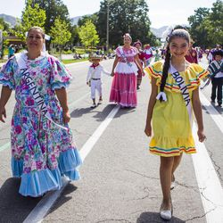 Jasmine Aguilar walks with a group representing different Latin American countries during the Days of '47 Union Pacific Railroad Youth Parade held Saturday, July 18, 2015, in Salt Lake City.