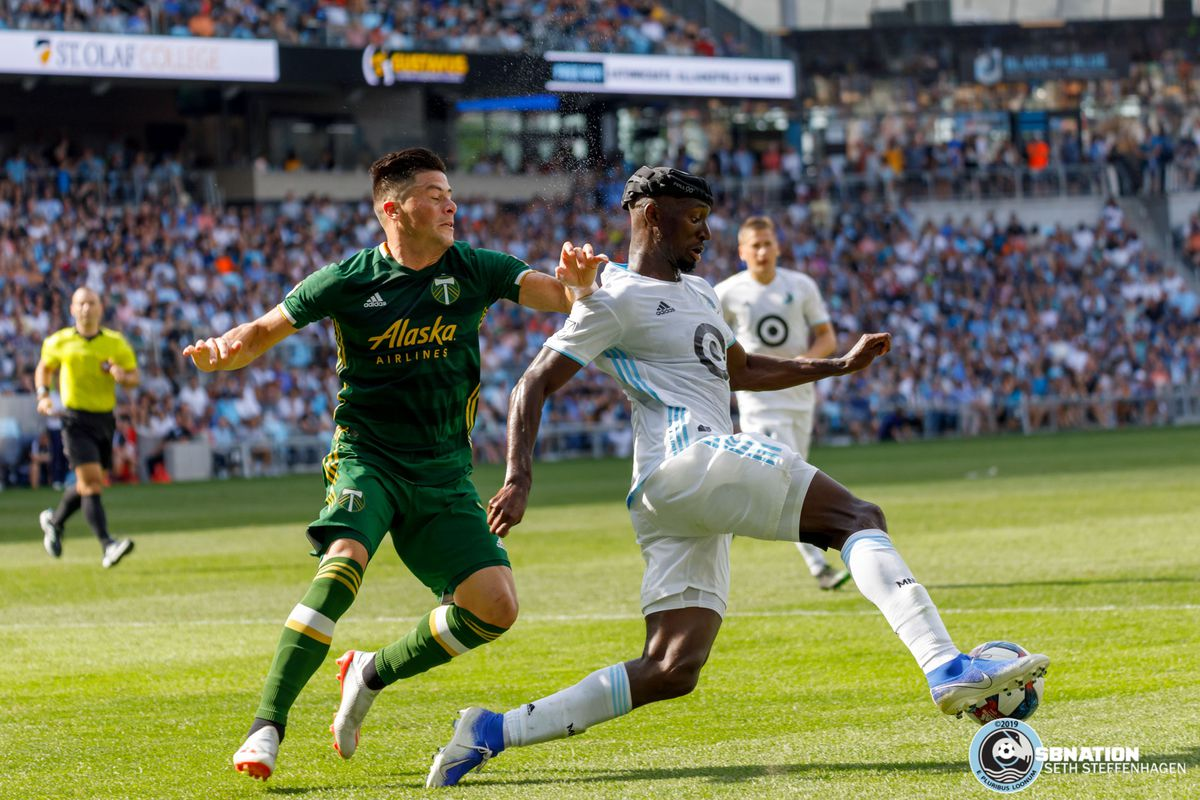 August 4, 2019 - Saint Paul, Minnesota, United States - Portland Timbers defender Jorge Moreira (2) is beat by Minnesota United defender Ike Opara (3) during the match at Allianz Field.