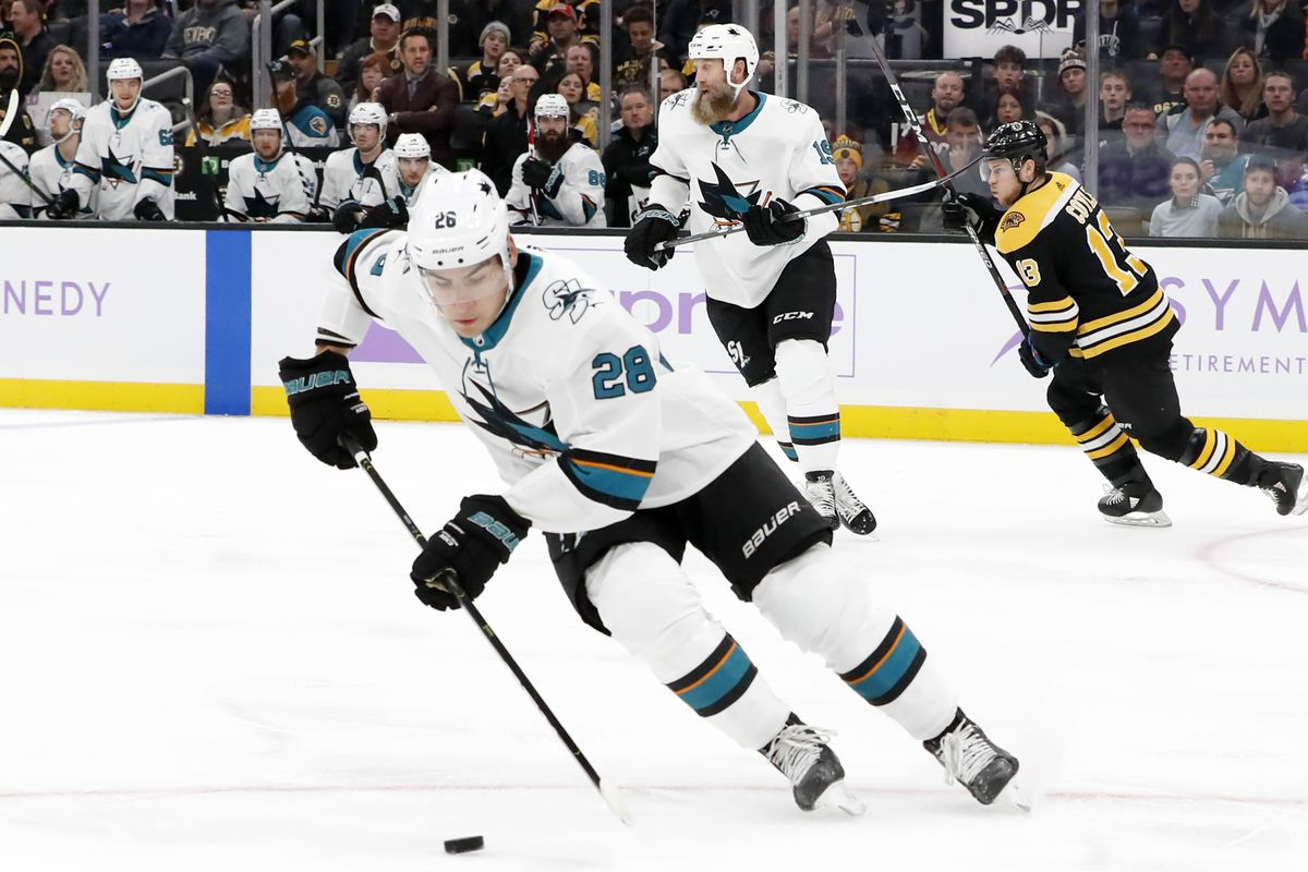 San Jose Sharks left wing Timo Meier (28) picks up the puck during a game between the Boston Bruins and the San Jose Sharks on October 29, 2019, at TD Garden in Boston, Massachusetts.