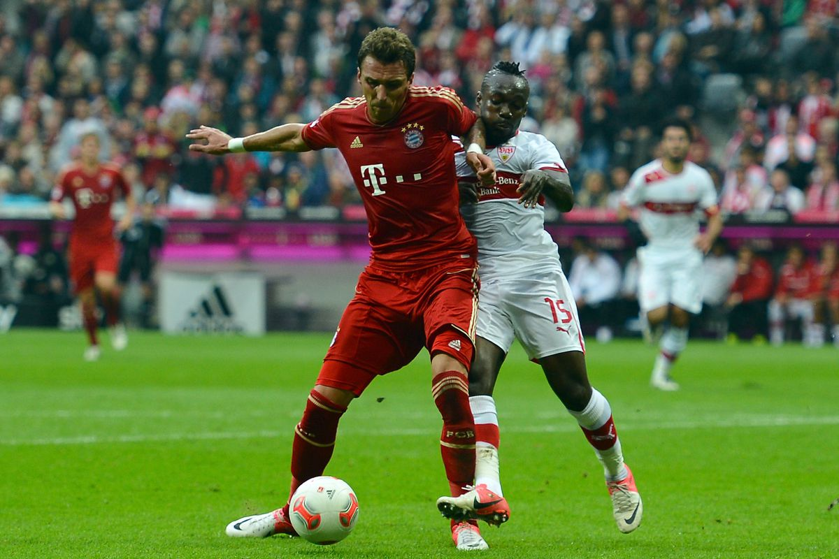 MUNICH, GERMANY - SEPTEMBER 02: Mario Mandzukic of Bayern Muenchen is challenged by Arthur Boka of VfB Stuttgart.