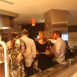 VIPs on a tour of the kitchen.