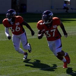 Broncos CBs Keyvon Webster (36) and Lorenzo Doss (37) move on the same path during drills at training camp