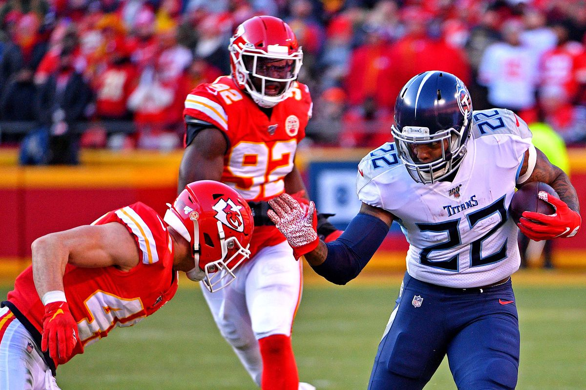 Tennessee Titans running back Derrick Henry runs the ball against Kansas City Chiefs defensive back Daniel Sorensen during the first half in the AFC Championship Game at Arrowhead Stadium