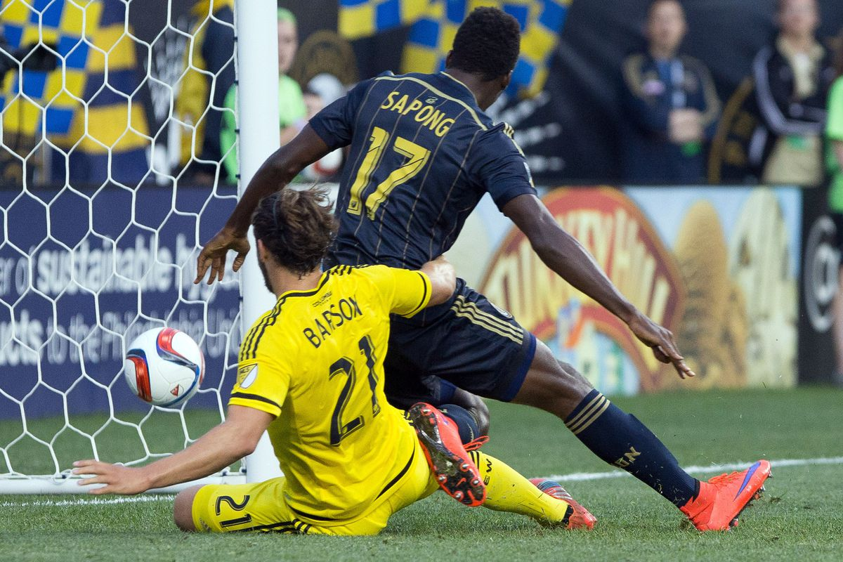 Philadelphia's C.J. Sapong scores in front of Columbus' Chad Barson in a 3-0 Union win on Wednesday.