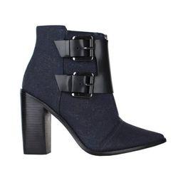 """<b>Tibi</b> Piper boot in black multi, <a href=""""http://www.tibi.com/shop/shoes/view-all/piper-boot-black-multi"""">$598</a>"""