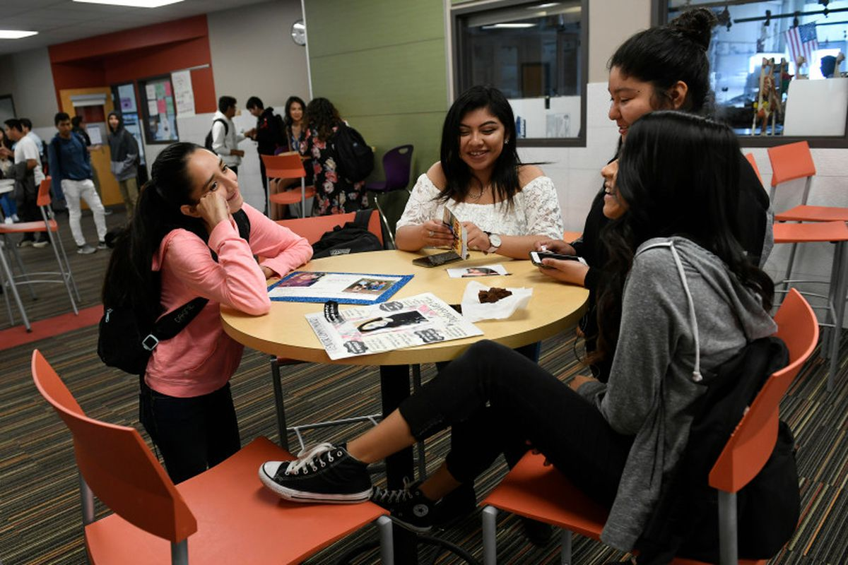 Students hang out in between classes at Academy High School on May 10, 2018 in the Mapleton district.