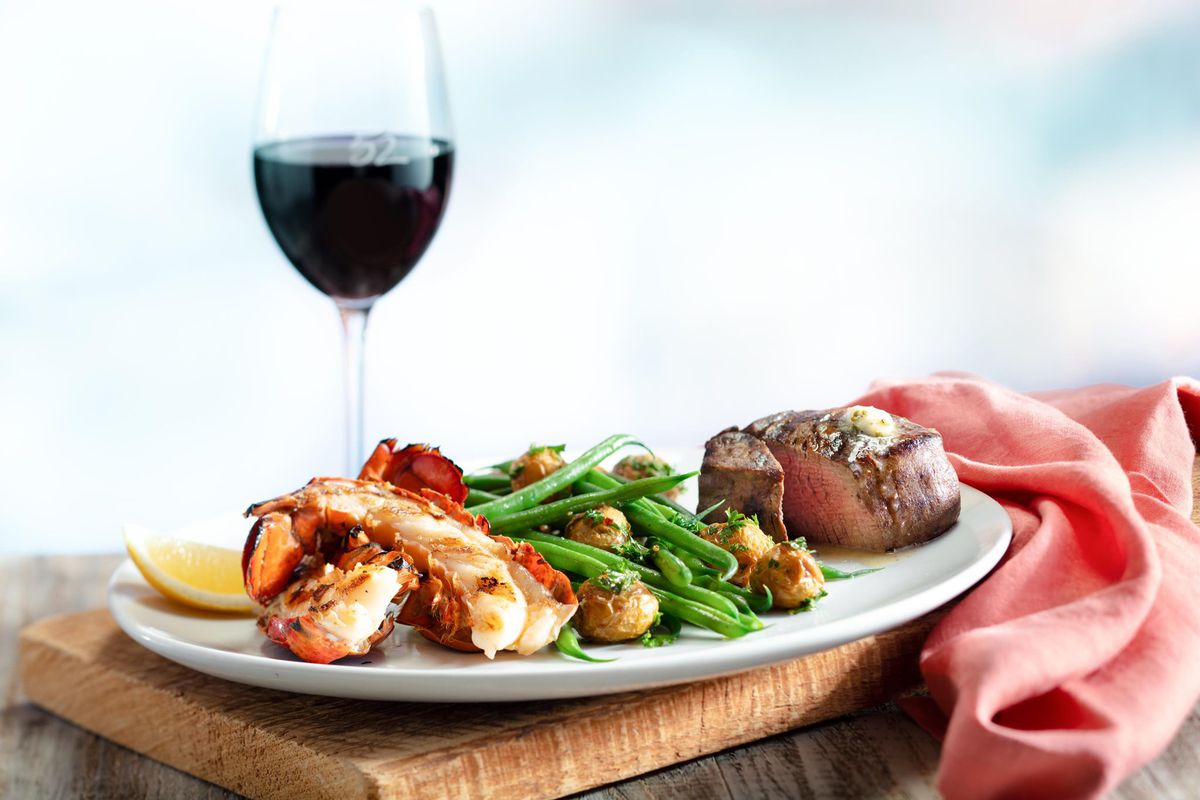 Wood-grilled filet mignon with a Maine lobster tail